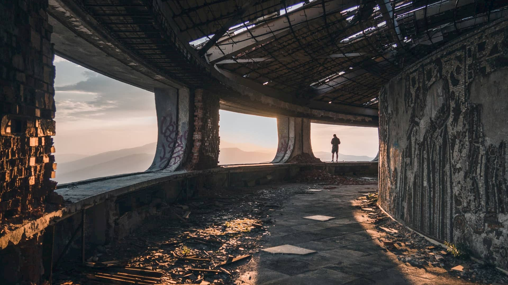 View from within the ruins of the Monument House of he Bulgarian Communist Party, built on Buzludzha Peak in central Bulgaria. Photo by Natalya Letunova on Unsplash